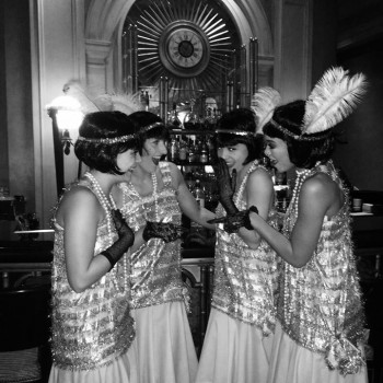 1920's flapper girls promotional models and commercial actresses posing in a bar