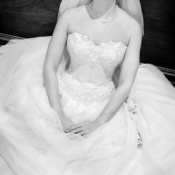 Model wearing white wedding dress