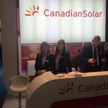 Exhibition staff working on stand for Canadian Solar