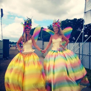 Stilt Walkers dressed in rainbow fairy costumes
