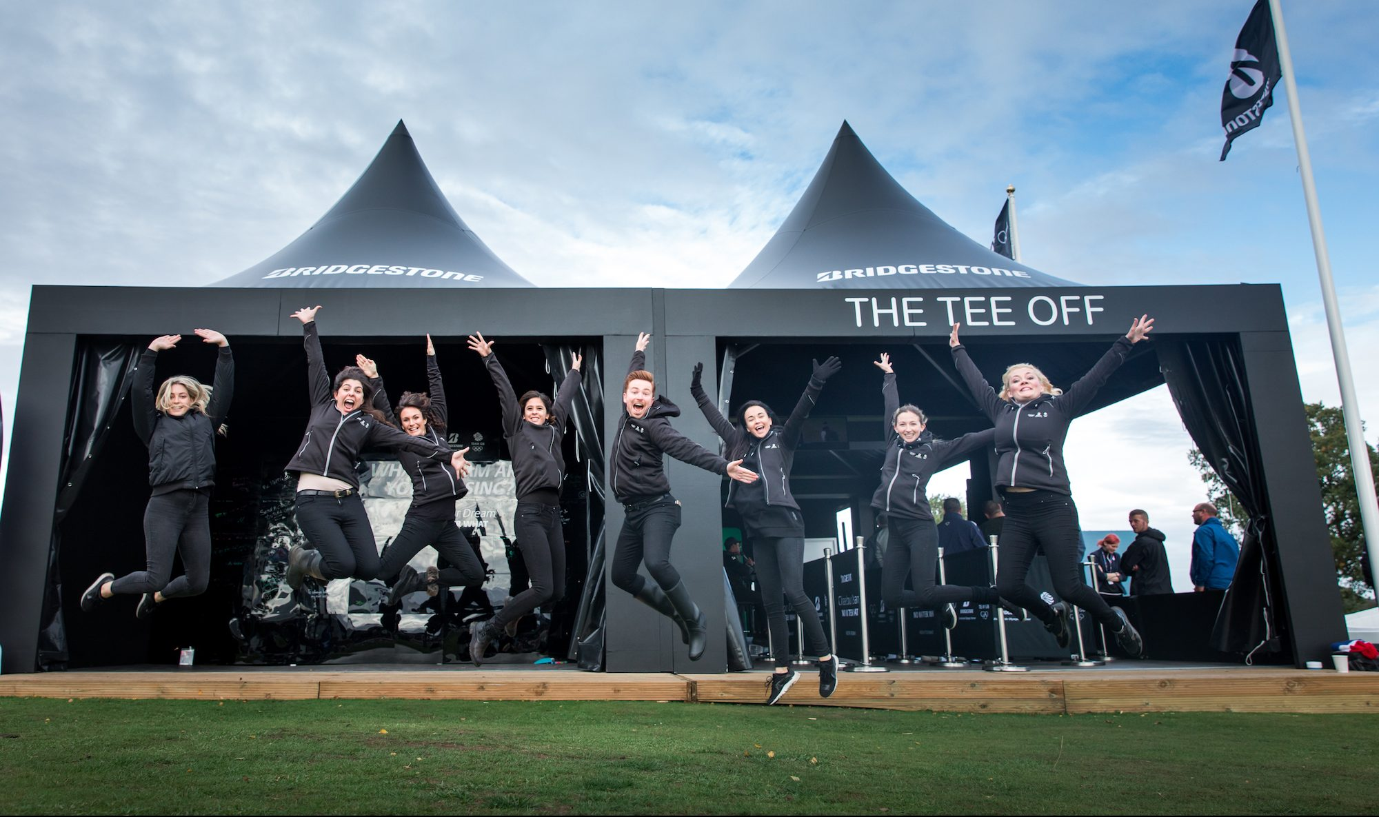 Bridgestone event team jumping with joy
