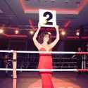 Ring girl dressed in red floor length gown