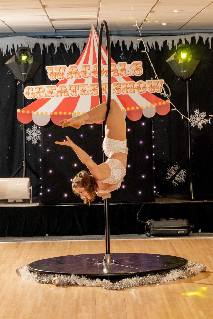 Aerial performer on freestanding hoop